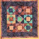 Mini-täcke gjort av Berit.
